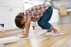 Kid Cleaning The Floor