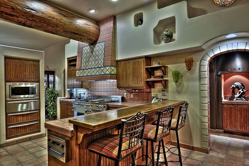spanish-style-kitchen-with-tile-backsplash-and-floors-with-breakfast-bar-2016