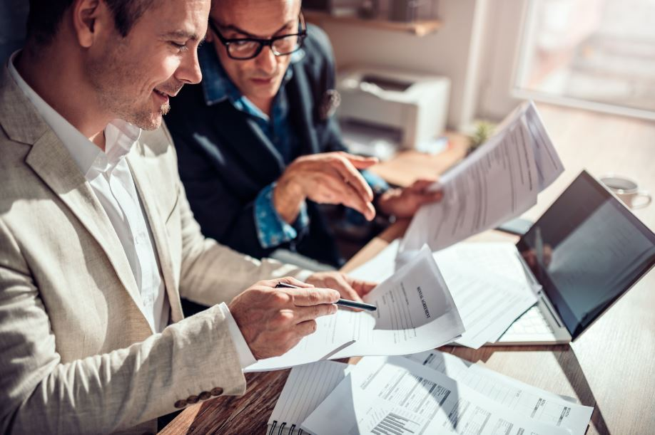 a lawyer and an investor looking at legal real estate documents