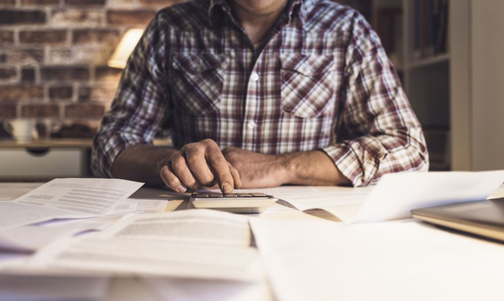 man considering how long to keep documents