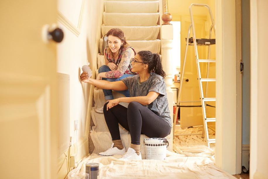 homeowners painting and renovating their new home