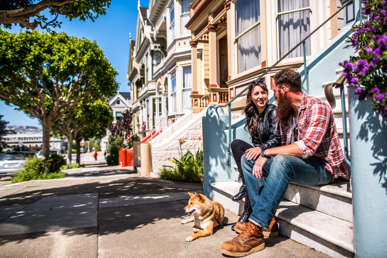 couple sitting in front of their townhouse