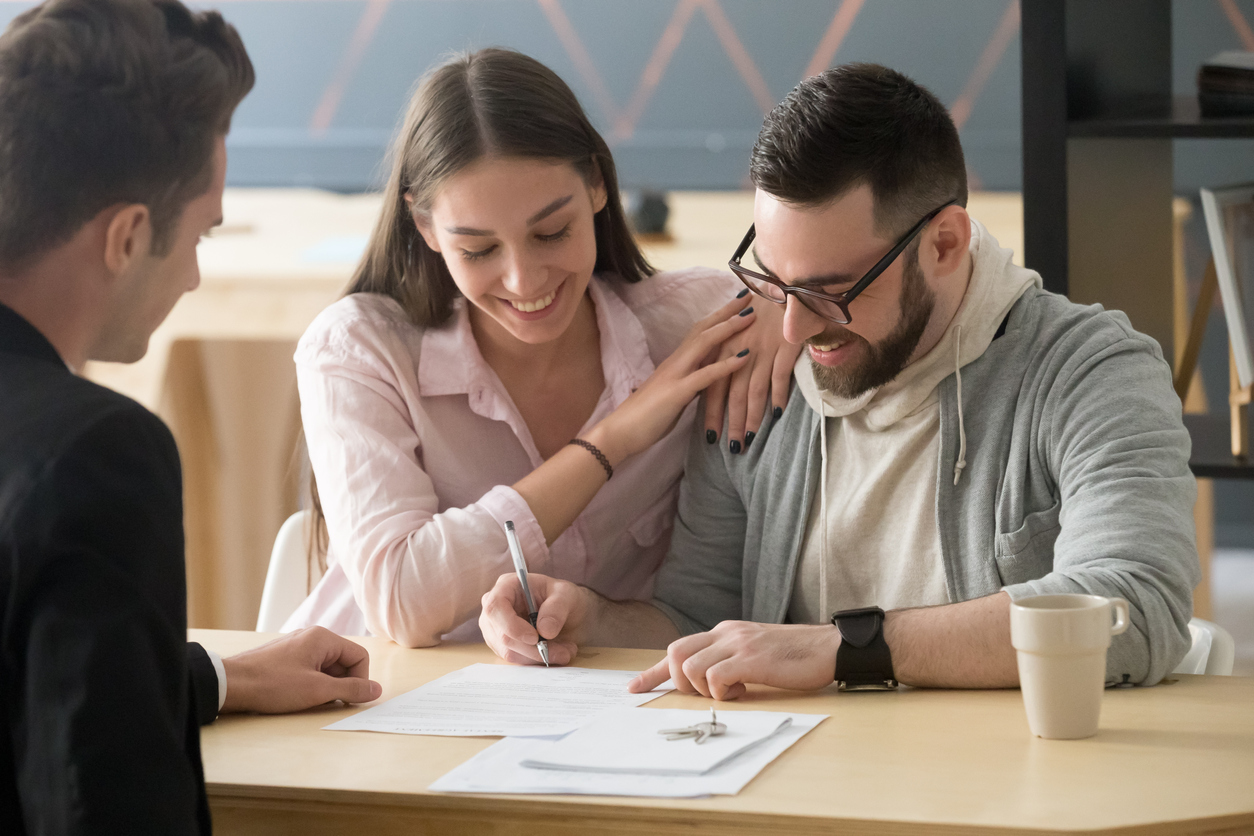 home buyers completing the closing process on a new home