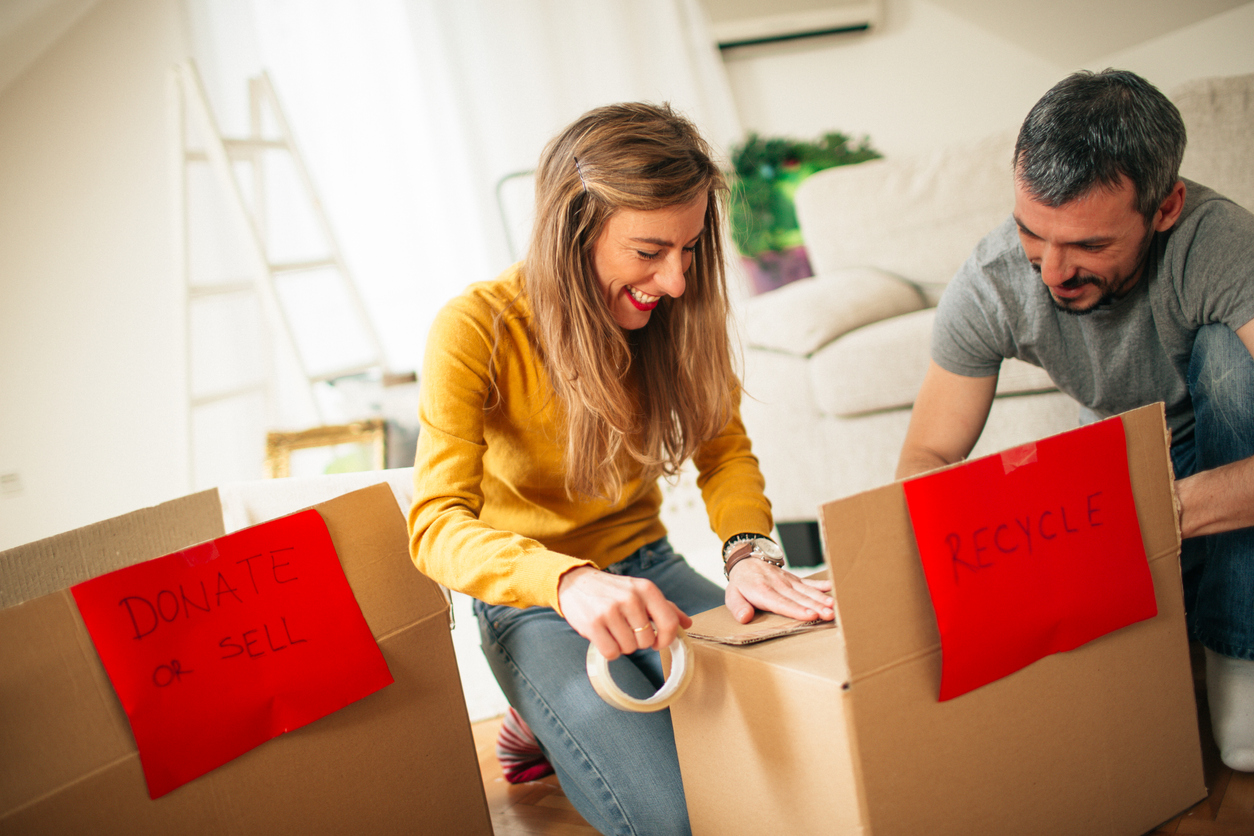 Couple packing up their apartment before moving to a new state
