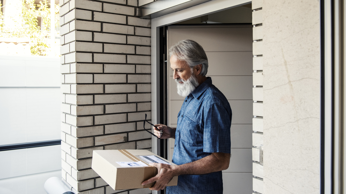 Man receiving packages he'd ordered online