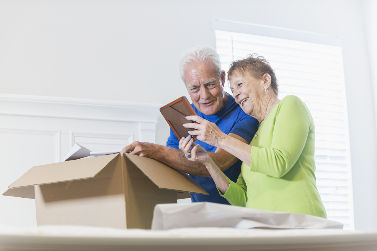 Older couple going through belongings as they pack for a move
