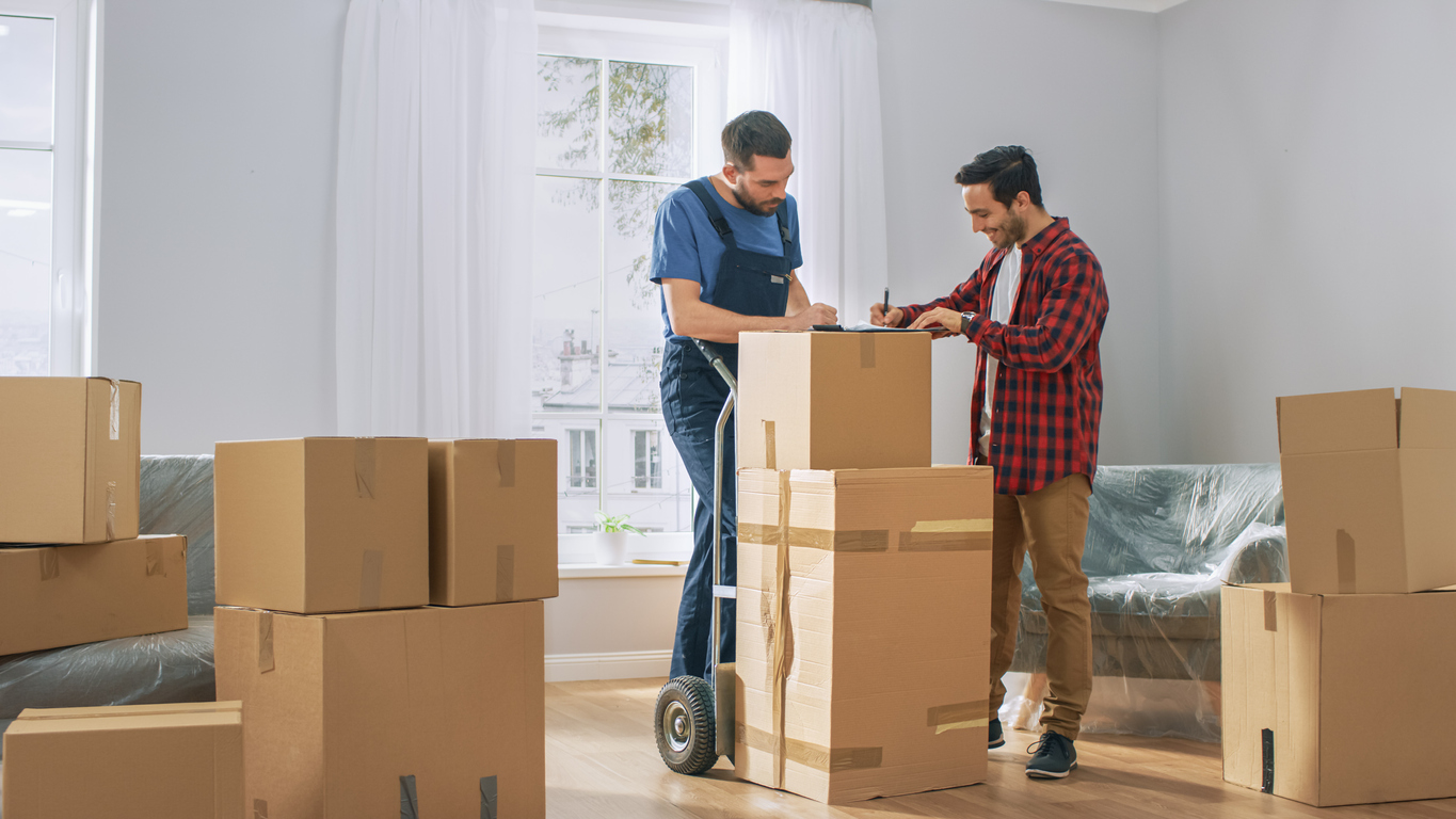 Homeowner talking with movers on move-out day