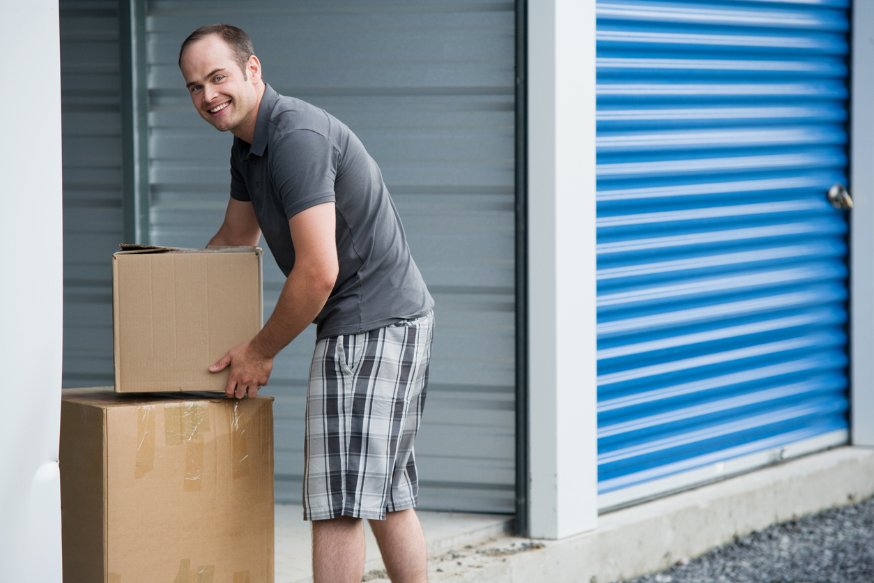 Man taking boxes out of an outdoor storage unit