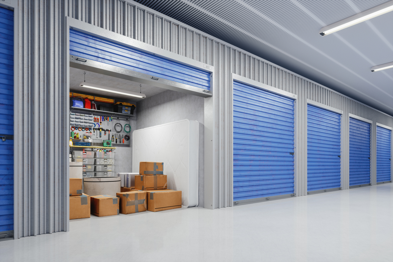 Open indoor storage unit filled with boxes and tools