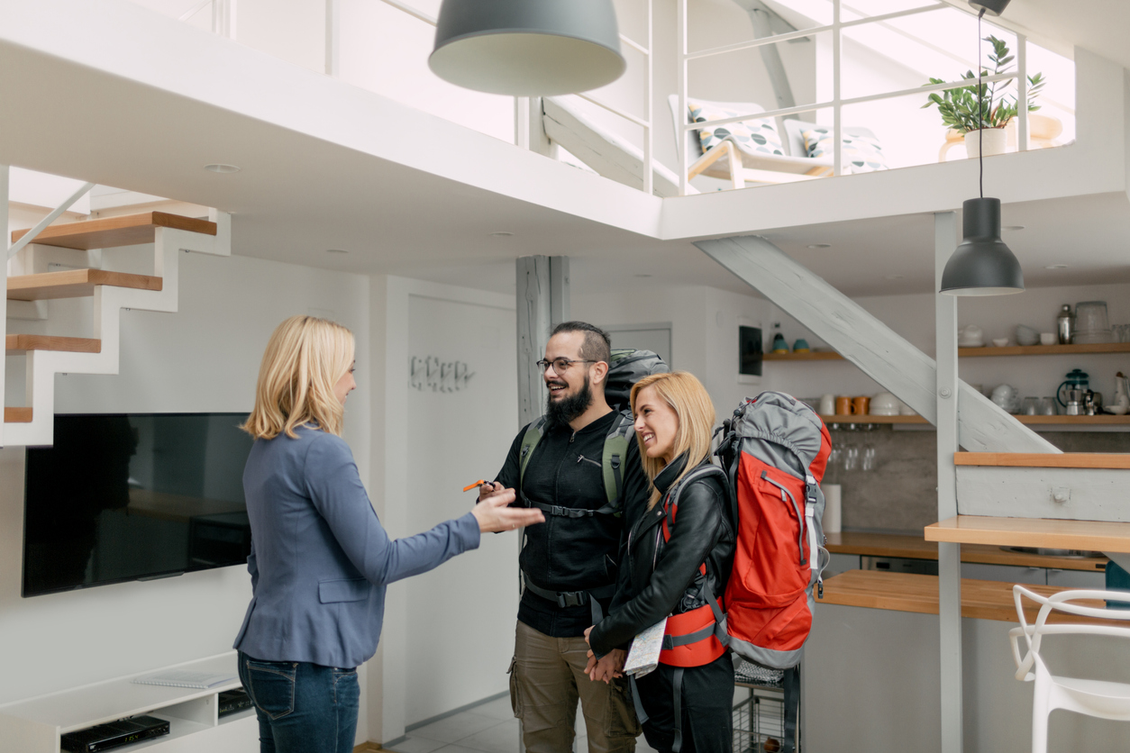 Host greeting and talking with vacationers as part of their vacation rental checklist