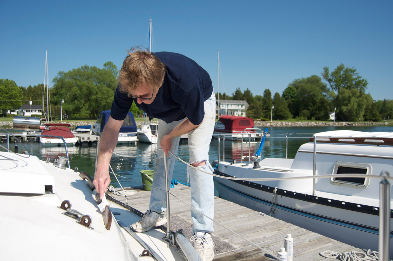 Owner scrubbing the finish of his boat