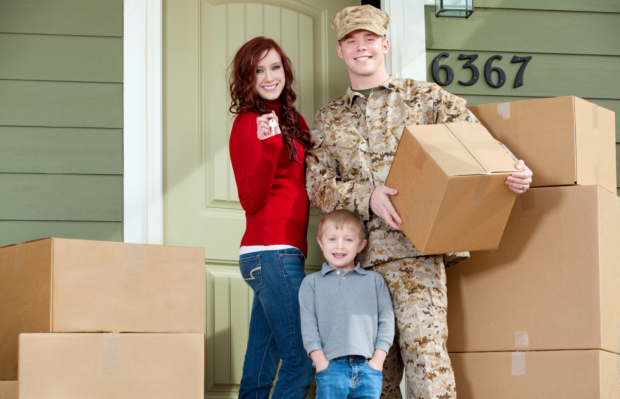 Military family packing boxes to move belongings into military storage units